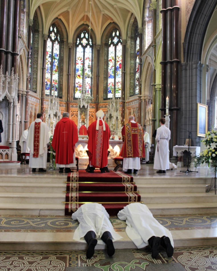 Deacon John McClelland and Michael Rooney prostrate themselves before the alter at yesterdays ceremony in Newry Cathedral.