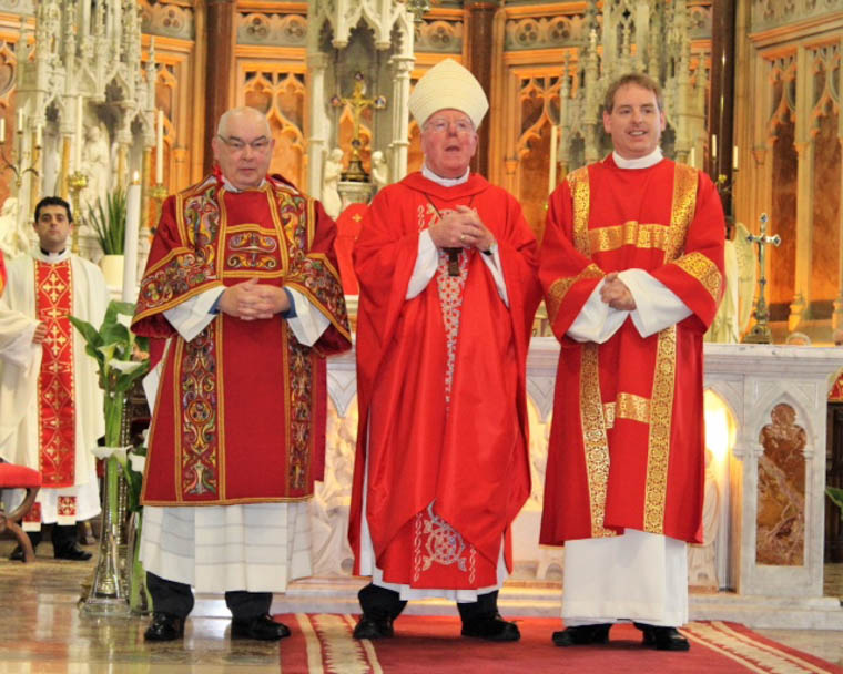 Permanent Deacons John McClelland and Michael Rooney with Bishop John McAreavey at their Ordination in Newry Cathedral.