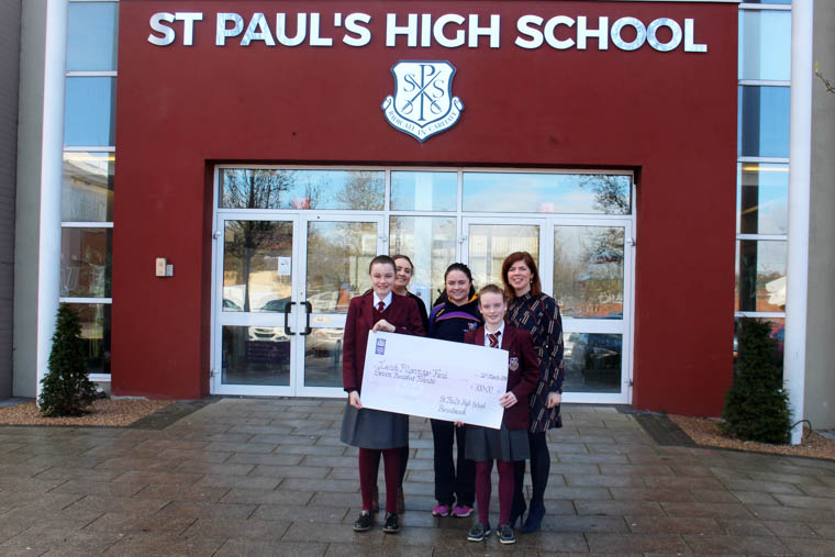 Niamh Rafferty of the Irish Pilgrimage Team accepts a cheque from Siofra Brennan and Aime McNally. Also in the picture is Mrs Marion McMahon, Siofra's form teacher and Niamh Watters, who will also travel to Lourdes at Easter.