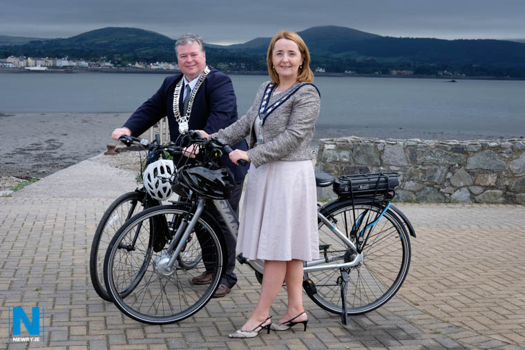 Cllr Roisin Mulgrew, Chairperson, Newry, Mourne and Down Council and Cllr Paul Bell, Cathaoirleach, Louth County Council get their bikes ready for the completion of the Newry to Omeath stretch of Carlingford Lough Greenway linking Newry to Carlingford. Photograph: Columba O'Hare