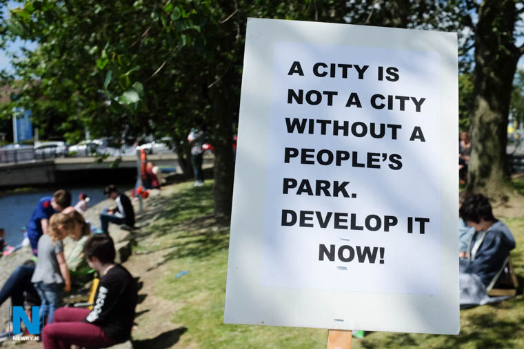 A campaigner spells out the message at a recent picnic on the Albert Basin site to highlight the lack of a city park in Newry. Photograph: Columba O'Hare