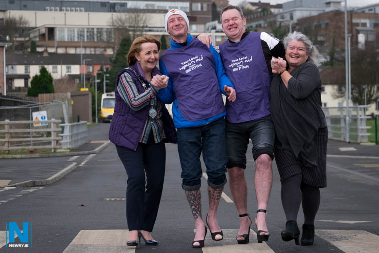 Eamon Murphy and Colm 'Bootsy' Fearon get a bit of a helping hand from Cllr Roisin Mulgrew, Chairperson, Newry, Mourne and Down District Council and Eileen Murphy, Women's Aid Armagh and Down when they tried to get some practice in for