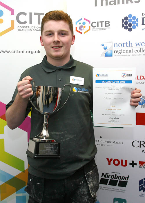 Cathal Murphy from Newry received a gold medal in Wall and Floor Tiling at Skillbuild NI