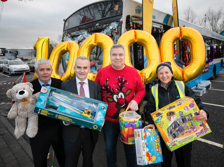 Kevin Wallace, Translink bus driver, with Chris Conway, CEO,Translink, Johnny Hero, U105 and Susan O'Neill, Translink bus driver, are pictured receiving generous donations from members of the public. Photo: Brian Morrison