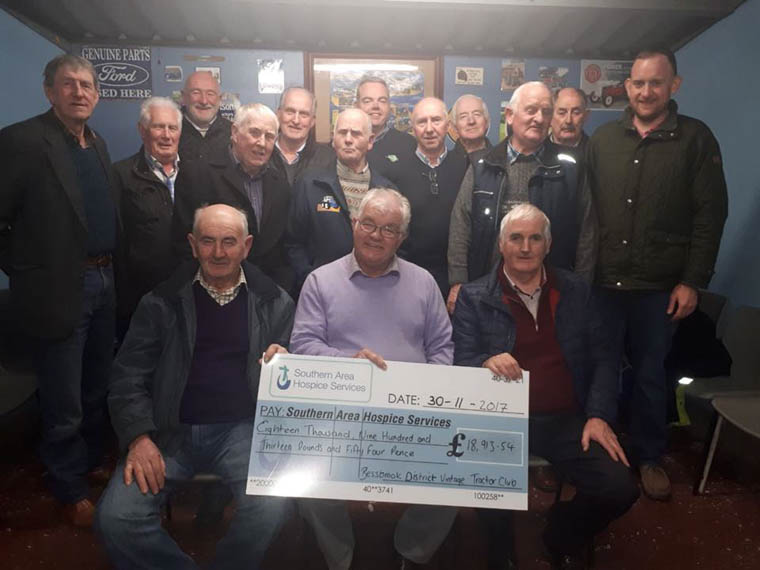 Members of Bessbrook District Vintage Tractor Club with their cheque for the Southern Area Hospice.