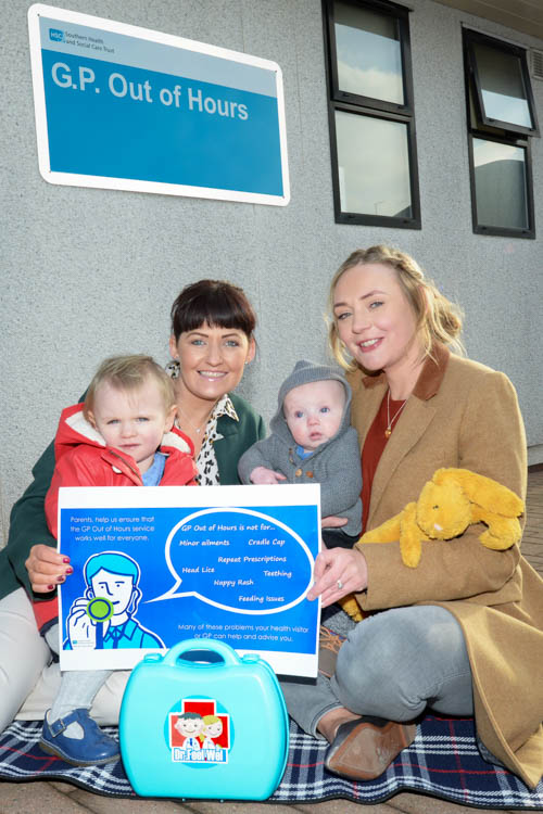 Health Visitor Clare Walsh with Emma Murtagh and her children Pippa and Henry who are teaming up to raise awareness amongst parents of how to make the best use of the GP Out of Hours service.