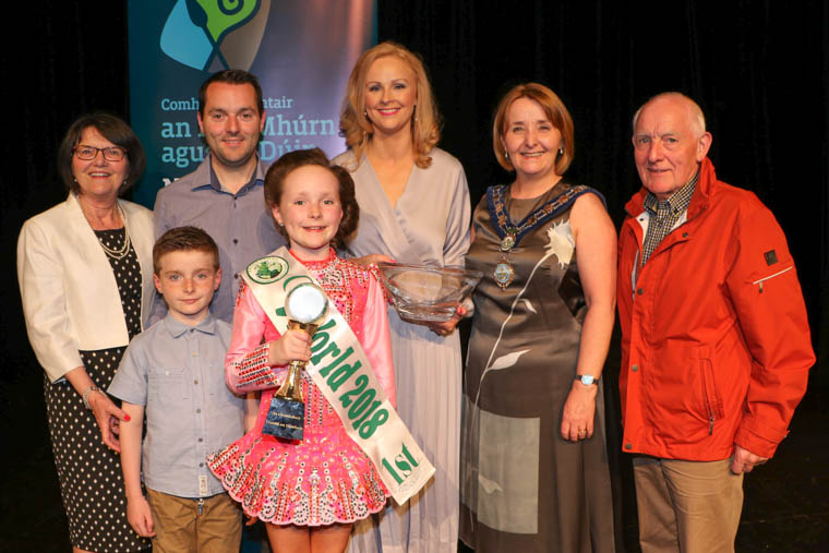Under 10 World Champion Irish Dancer Eimear Gallagher Award Recipient at Newry Awards Ceremony with her family, Granny Goretti Gallagher, Mark, Joseph, Paula with Chairperson Newry, Mourne and Down District Council, Councillor Roisin Mulgrew and Grandad Thomas Gallagher at Newry Awards Ceremony.