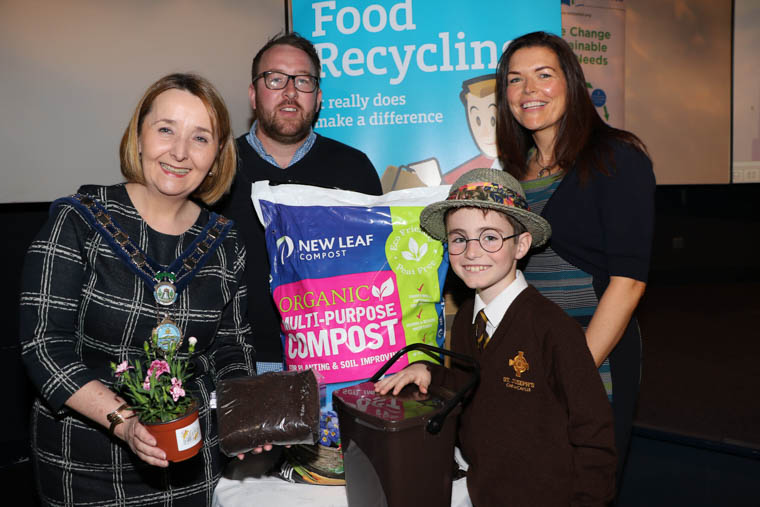 Getting ready for Compost Awareness Week are Chairperson Newry, Mourne and Down District Council, Councillor Roisin Mulgrew, Daniel Murray Sponsor Natural World Products and Tara Cunningham NMDDC Recycling Officer with 'Seamus the Compost Expert' alias Conor Hale St. Joseph's Primary School, Carnacaville.