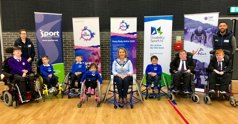 Pupils from St Mark's Secondary School and St Clare's Abbey Primary School along with Chairperson, Councillor Roisin Mulgrew and Newry, Mourne and Down District Council's Everybody Active 2020 coaches at the the launch of the district's Disability Sports Hub.