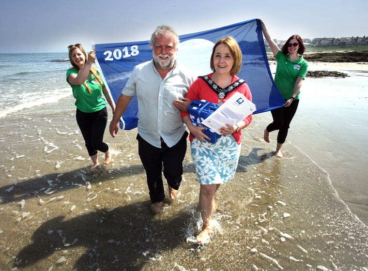 Simon Boyle from Newry, Mourne and Down District Council and Council Chairperson, Councillor Roisin Mulgrew, celebrate the Blue Flag success of local beaches.