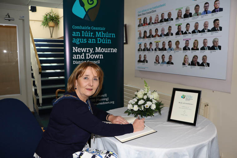 Chairperson Newry, Mourne and Down District Council, Councillor Roisin Mulgrew signs the Book of Condolence in memory of those who lost their lives in Gaza on 14th May 2018.