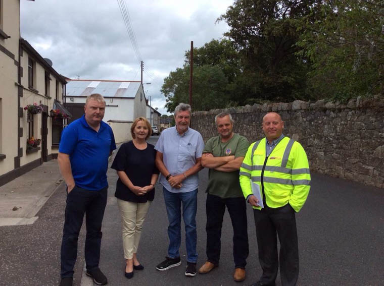 Cllr Roisin Mulgrew and MP Mickey Brady pictured with Roads Service & local residents at the meeting in High street.