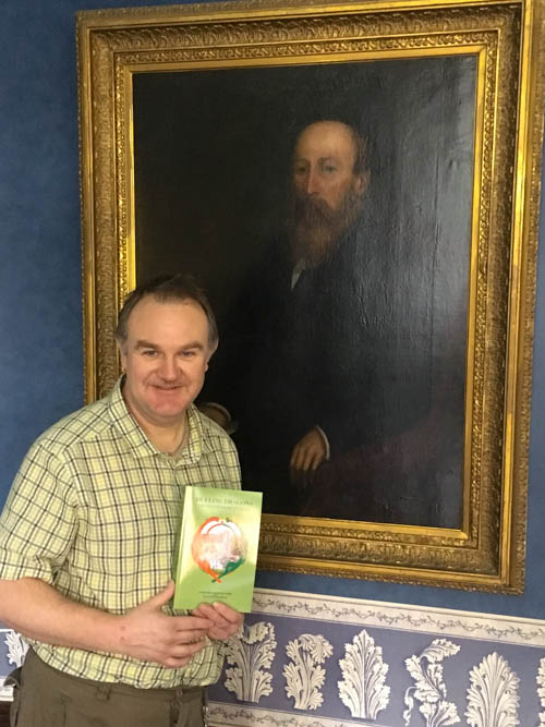 Young Ireland enthusiast - Adrian Murdock - from Loughorne pictured in front of the John Martin painting with a copy of Marjorie Harshaw Robie's new book.