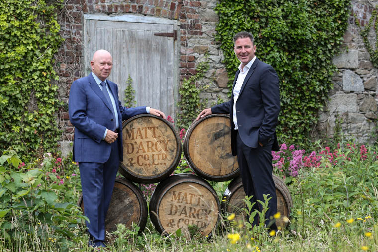 Whiskey Galore - Michael McKeown, left, owner and investor of Matthew D'Arcy & Company with Andrew Cowan, Chief Executive, Matt D'Arcy & Company making plans for the transformation of the Monaghan Street site. Photograph: Kieran McAlinden Photography