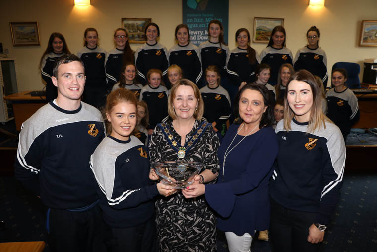 Pictured at the Our Lady's U20 presentation. From left: Coach Thomas Hackett, Team Captain Ellen Bradley, Chairperson Newry, Mourne and Down District Council, Councillor Roisin Mulgrew, Principal Fiona McAlinden and Coach Niamh Murray accept an inscribed crystal bowl to mark the U20 Team Ulster Gaelic Competition Winners at a Council Reception to mark their success.