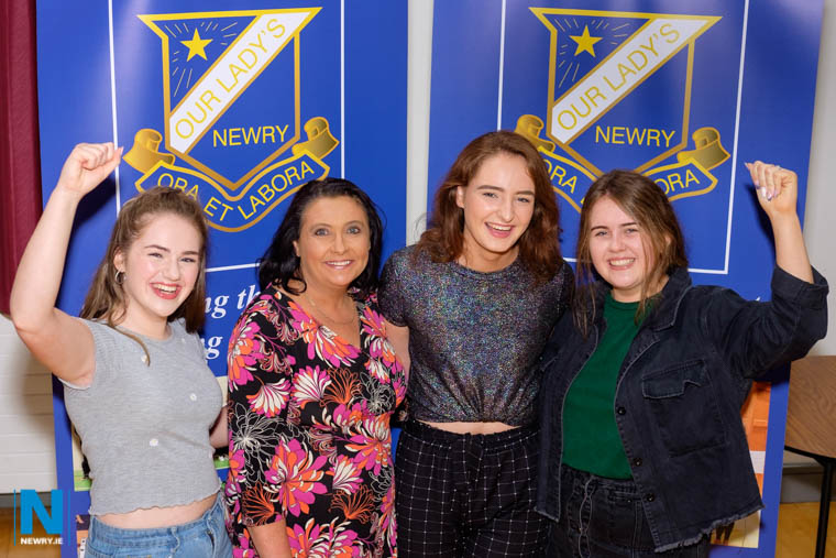 Our Lady's Principal, Mrs Fiona McAlinden is pictured with Head Girl, Aoife Hollywood and Deputy Head Girls Niamh Carey and Sara McMullan who between them have achieved 5 A* and 6 A grades at A Level.