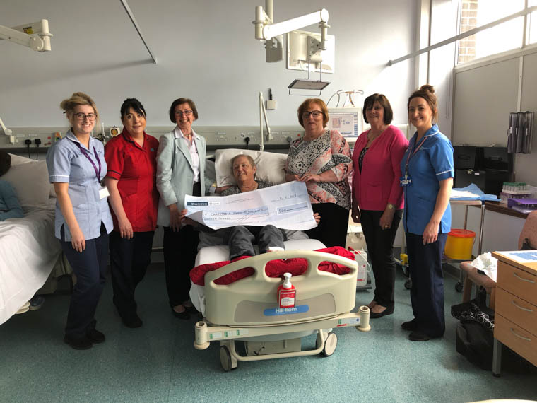 Pictured making the presentation to the Daisy Hill Hospital Renal Unit are from left: Renal Unit Health Care Assistant, Sarah Finnegan, Sr Kay Donegan, Marion McGee Chairwoman of Armagh and District Floral Art Society, Patient Ruth Gillespie, Pauline White, Muriel Totten and Staff Nurse, Lyndsay McVicker.