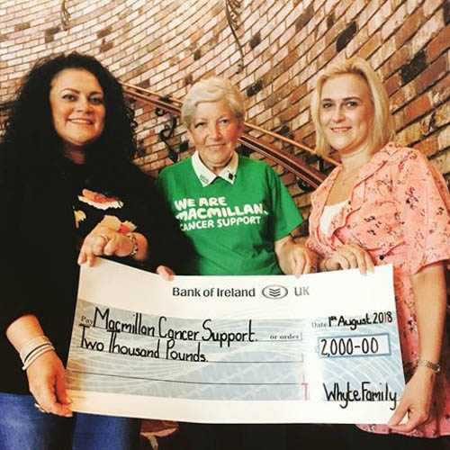 Sisters Belinda O'Neill & Claudia McAvoy are pictured presenting Martha McGrath from Macmillan Cancer Support, Newry Branch, with a donation of £2,000 following the recent success of their Ladies Charity Sparkling Afternoon Tea