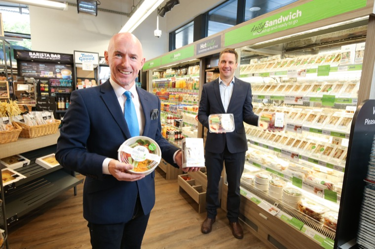 Philip Morgan, Sales Director at Around Noon and Gareth McAnlis, Food Development Manager, Fresh Foods at Henderson Wholesale pictured at a EUROSPAR branch with a selection of Around Noon's pre-packed sandwiches, wraps, and salads.