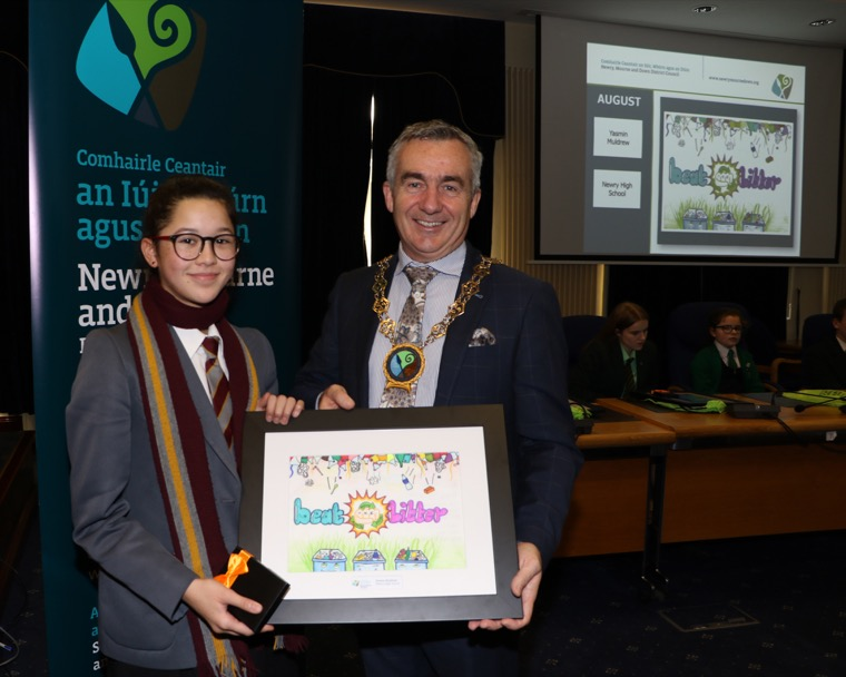 Chairman Newry, Mourne and Down Council, Councillor Mark Murnin with the School's Environmental Calendar Poster August Winner Yasmin Muldrew Newry High School.