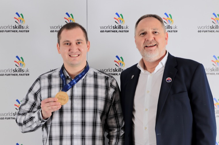 Pictured receiving his gold medal from Arwyn Watkins, managing director of UK apprenticeship specialist Cambrian Training is Salius Repecka from Armagh City.