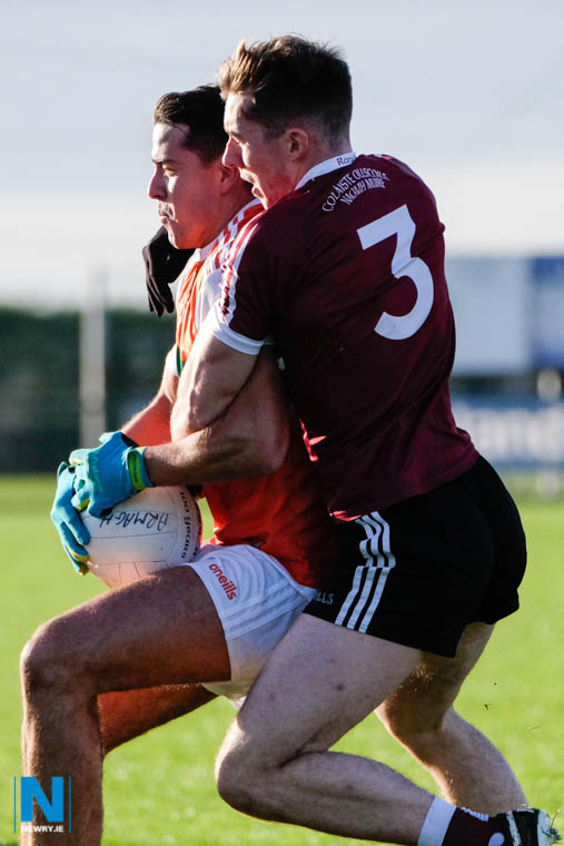 Armagh's Stefan Campbell tries to fend off St Mary's Caolan Dillon at Crossmaglen. Photograph: Columba O'Hare/ Newry.ie