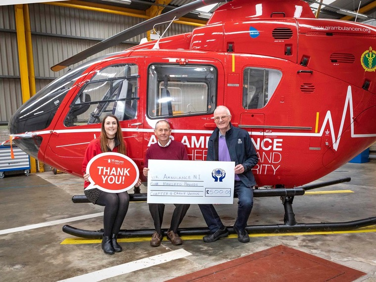 Coleen Milligan, Air Ambulance NI receives a cheque for £500 from John Corrigan, Chairman and Brian O'Hare, PRO, Chapter 4, Irish League of Credit Unions.