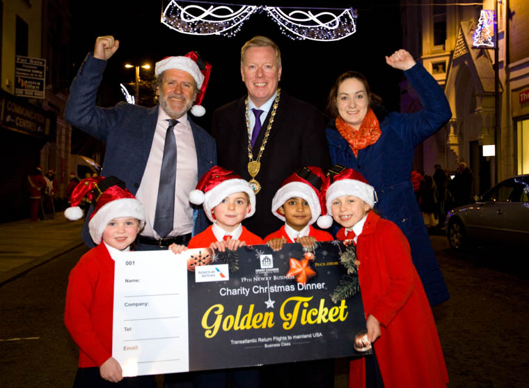 Declan McChesney Chairman of the Newry Business Christmas Charity Committee, Newry Chamber of Commerce President Paul Convery and the elves from St Joseph's PS, Newry  -Eve, Callum, Aaron and Farah - who will assist in building the toy mountain for local charities, on 6th December in the Canal Court, Newry.
