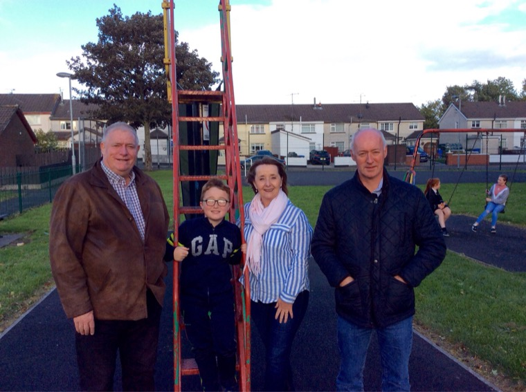 Cllr Roisin Mulgrew pictured with local Community activists  Declan McDonald, Declan Murphy & some of the young people who will enjoy the facilities