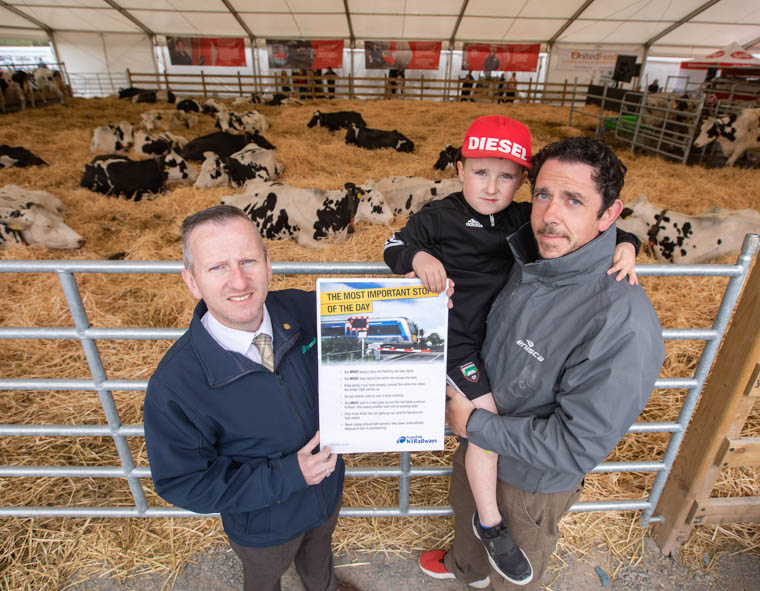 Level Crossing Risk Coordinator Keith Pollock (left) explains the importance of rail safety to Stephen and Archie Boyle from Mullaghbawn, Newry, at the Balmoral Show.