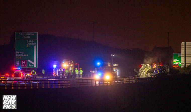 Emergency crew on the scene of the incident at the Camlough exit of the A1. Photograph: NewRayPics.com