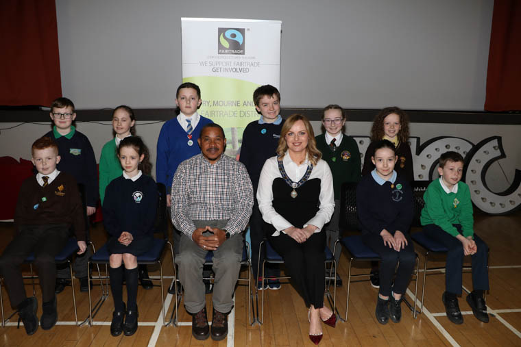 Fairtrade Farmer from Banelino, Dominican Republic, Blas Arismendis Marcelino Guzman, Deputy Chairperson Newry, Mourne and Down Council, Councillor Oksana McMahon and a representative from each school who attended the Fairtrade Fortnight Schools Event in Newcastle Community Cinema. Back row l-r Jack Vance Bunscoil Bheanna Boirche, Clara O'Hare St. Patricks PS Drumgreenagh, Ryan Ritchie Crhist the King PS Ballynahinch, Aisling Vaughan St. Malachys PS Kilclief, Mia Murphy St. Malachys PS Camlough, front row l-r Oisin Murray St. Josephs Ps Carnacaville, Lily Farmer St. Oliver Plunketts PS Forkhill, Fairtrade Farmer Blas Arismendis Marcelino Guzman, Deputy Chairperson Newry, Mourne and Down Council, Councillor Oksana McMahon, Maria Watterson St. Patricks PS Legamaddy, Joel Reynolds, Our Lady and St. Patricks PS Downpatrick.