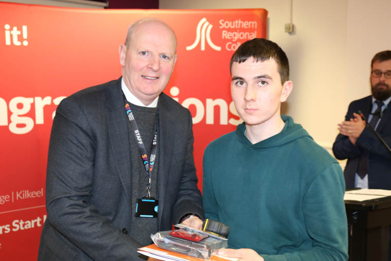 Adam McCullough from Camlough, who won the Electrical Installation competition, with Brian Doran, SRC Chief Executive