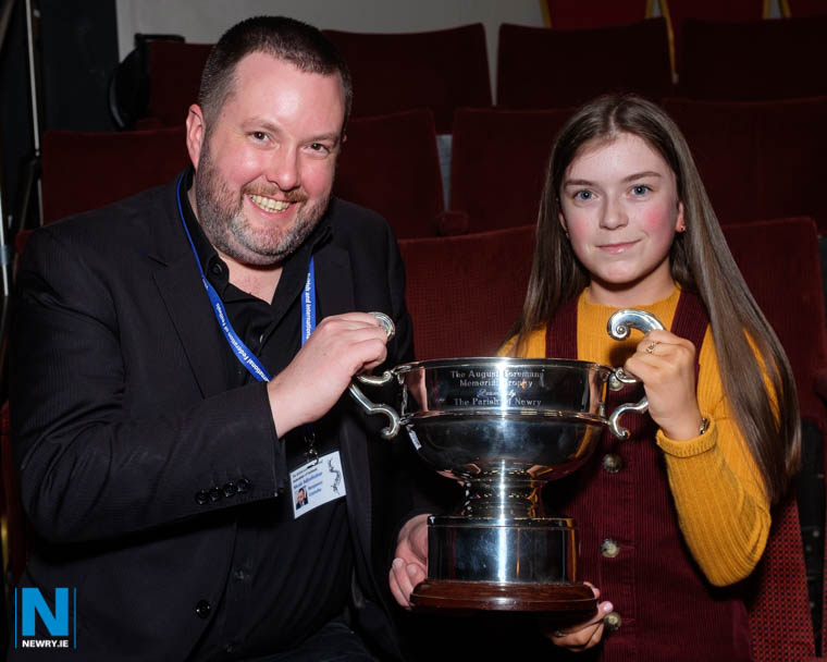 Adjudicator Benjamin Costello presents the August Toremans Memorial Cup to Ellie McKevitt for her Under 14 set piece at Newry Musical Feis. Photograph: Columba O'Hare/ Newry.ie