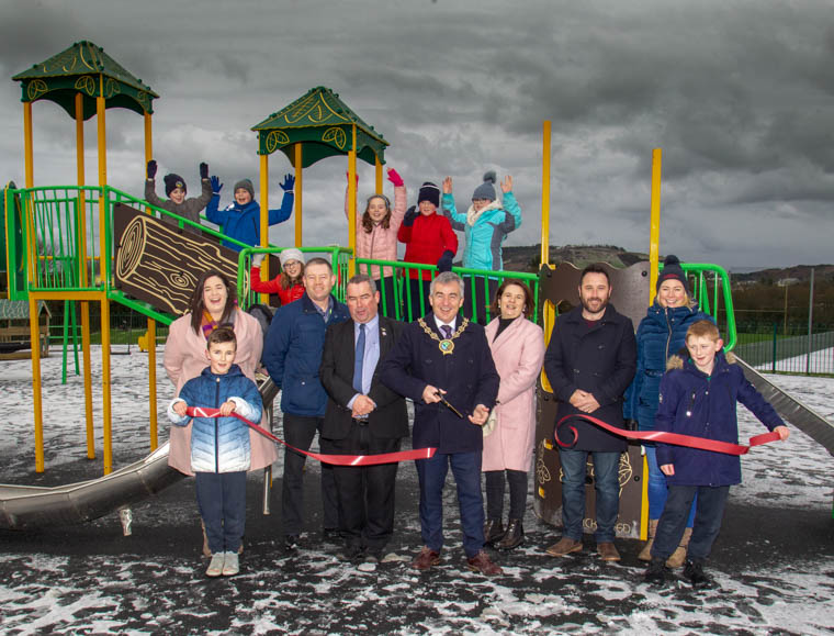 Newry, Mourne and Down District Councl Chairman, Mark Murnin celebrates the opening of Drumintee Play Park with councillors and children from Drumintee Primary School.
