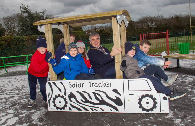 Newry, Mourne and Down District Council Chairman, Mark Murnin, with children from Drumintee Primary School at the opening of Drumintee Play Park.