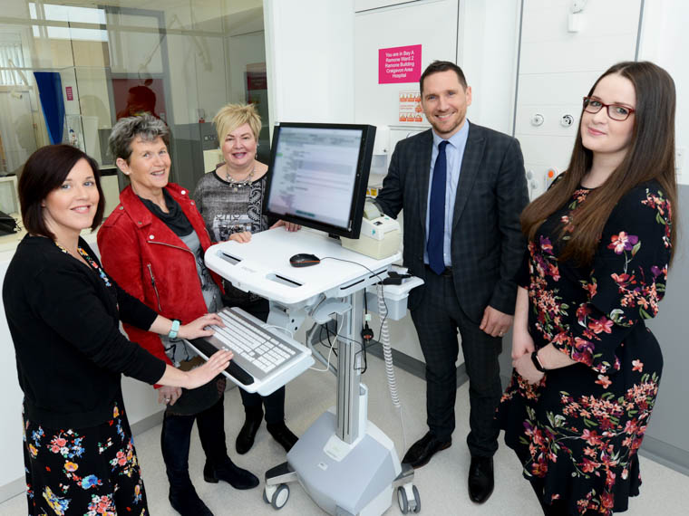 The Southern Trust has introduced a new electronic system to improve safety and timeliness when discharging patients from Craigavon and Daisy Hill hospitals.  Pictured demonstrating the system are Collette McCaul, Service Administrator, Dr Rose McCullagh, Associate Medical Director for Primary Care, Katherine Robinson, Booking and Contact Centre Manager, Mark Toal, Head of Technology Innovation and Bridin O'Hare, IT System Support Officer.