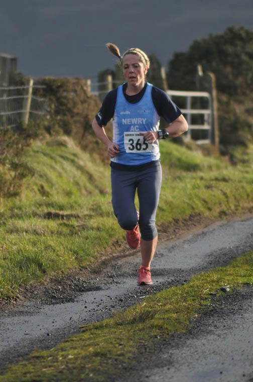 Ciara Coffey running strong to finish 1st Female in The Burren Townland 10 miler