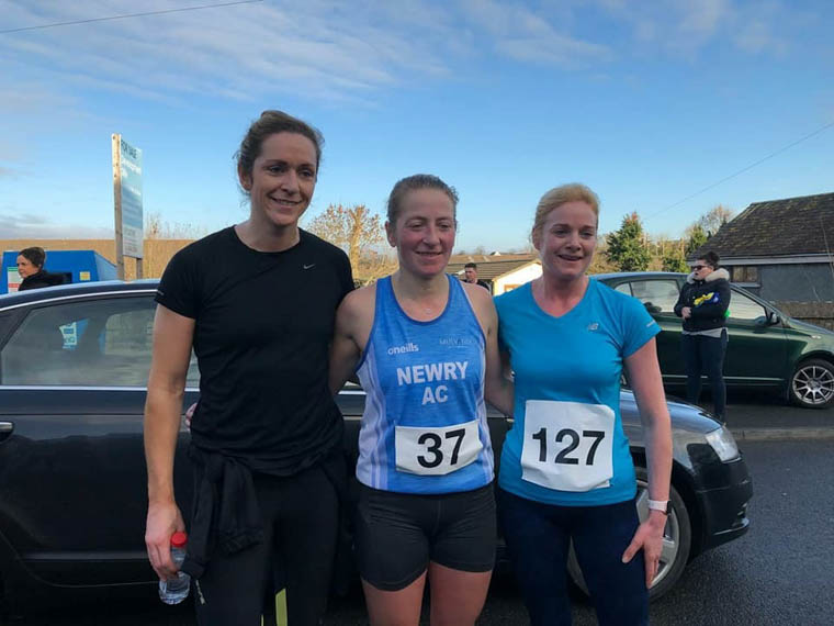 Esther Dickson (Centre) lifted 1st Female in the hilly Run for Raff 10k
