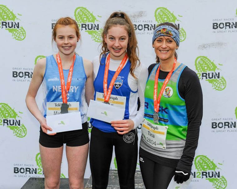 Meadow McCauley (left) lifting 2nd placed female at the Born2Run Tollymore 5k