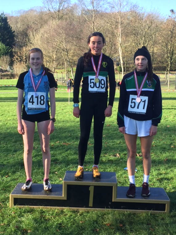 Meadow McCauley (L) lifting 2nd Place in the Intermediate Race at the Schools Districts Cross Country (Armagh)