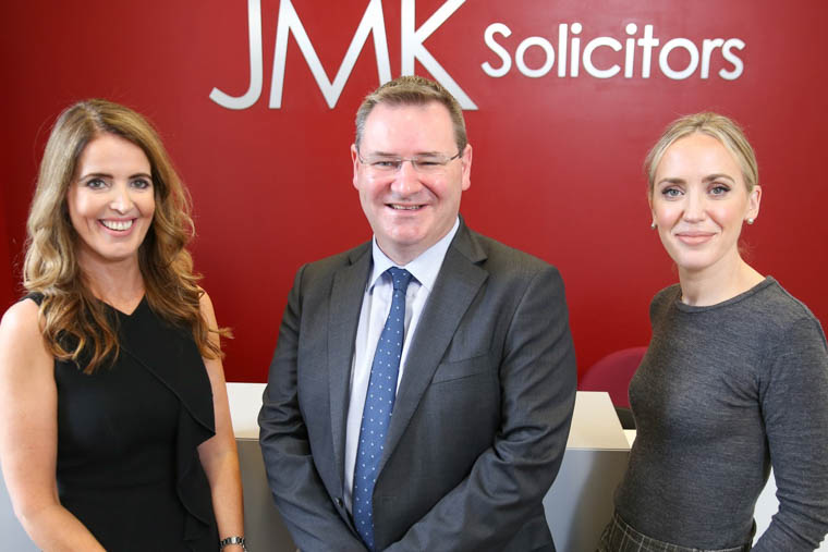 JMK Solicitors are Northern Ireland's No. 1 Personal Injury firm for 5th year in a row. Pictured are Maurece Hutchinson, Managing Director, Jonathan McKeown, Chairman and Olivia Meehan, Legal Services Director.