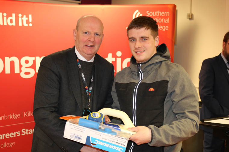 Joshua Byrne from Newry, who won the Plastering competition, with Brian Doran, SRC Chief Executive.