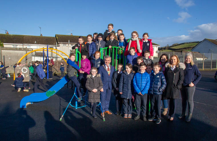 Newry, Mourne and Down District Council Chairman, Councillor Mark Murnin launches the new play park in Barr Crescent, Lurganare alongside children, teachers from the local school and local councillors.