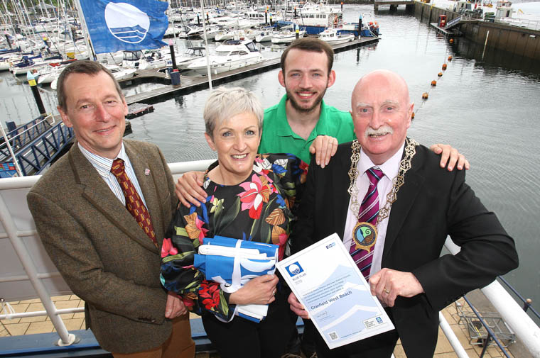 Ian Humphreys, Chief Executive, Keep Northern Ireland Beautiful, Barbara Fleming – Ovens, Beach Operator, Newry, Mourne and Down District Council, Jamie Millar, Keep NI Beautiful and Newry, Mourne and Down District Council, Chairperson Cllr Charlie Casey celebrate the award of Blue Flag status for Cranfield, Tyrella and Murlough beaches.