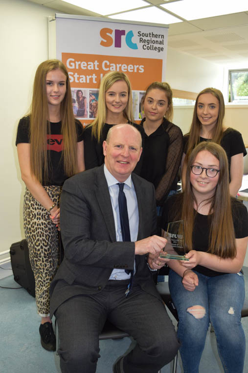 Mr. Brian Doran, Chief Executive at SRC presents the award to the student team from the Level 3 Extended Diploma in Business who won the Project Based Learning Award – Communication Category: Back Row (L-R): Rachel Whitten, Sara Gibson, Lydia Boyd, Rebekah McCullough Front Row (L-R): Brian Doran (Chief Executive, SRC), Beth Hawthorne