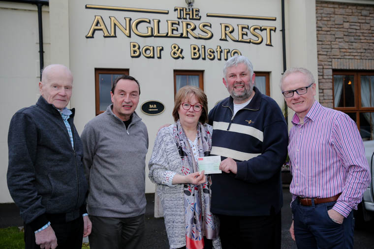 Bobby Ingram, Alan Dowdeswell, Howard Anderson, and Kirk Hanlon of Rathfriland Motorcycle Club present a cheque for £1000 to Sheila Carragher (MS Community Therapy Centre).