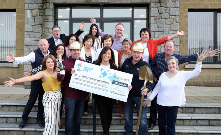Michelle O'Hare, Gareth Tinnelly and members of the Tinnelly Group Lottery Syndicate celebrate their £253,489.30 EuroMillions win at the demolition company's headquarters in Newry.