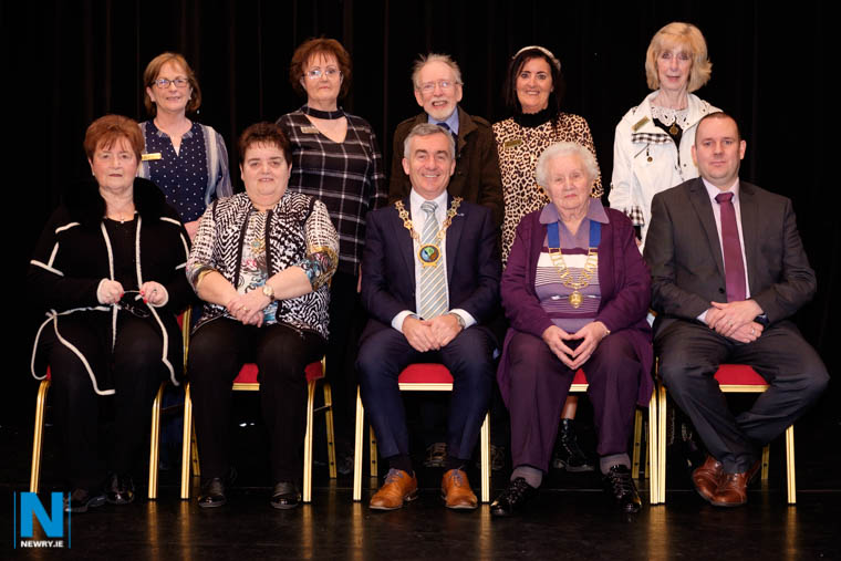 Opening the 2019 Newry Musical Feis were front from left: Sheila Nolan, Vice President, Newry Feis; Maria Moan, Assistant Secretary, Dance; Cllr Mark Murnin, Chairman, Newry, Mourne and Down District Council;  Alma Brown, President, Newry Musical Feis and Alan McCormick, Adjudicator. Back from left: Marie Cassidy, Assistant Speech and Drama (Open); Catherine Kerrin, Section Secretary, Speech and Drama (Open);  Roly Anketell, Assistant Secretary, Music Section; Barbara Cummings, Assistant Secretary, Music and Eileen Ferguson, Secretary, Traditonal Irish Music. Photograph: Columba O'Hare/ Newry.ie