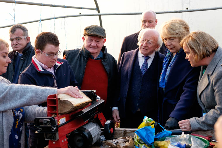 President Michael D. Higgins and his wife Sabina visited An Tobar in Silverbridge on Thursday are are pictured watching one of the social farming participants breaking logs. Photograph: Columba O'Hare/ Newry.ie